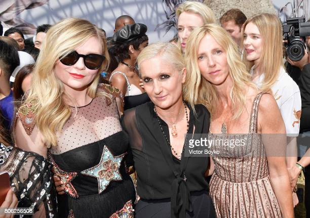 Kirsten Dunst Maria Grazia Chiuri and Sandrine Kiberlain attends the Christian Dior Haute Couture Fall/Winter 20172018 show as part of Haute Couture...