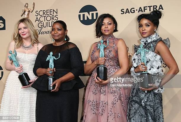 Kirsten Dunst Octavia Spencer Taraji P Henson and Janelle Monae pose in the press room with their award for Outstanding Performance by a Cast in a...