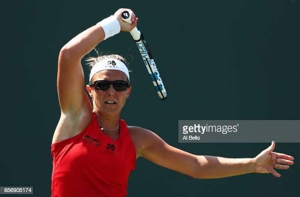Kirsten Flipkens of Belgim returns a shot against Ana Konjuh of Croatia during Day 4 of the Miami Open at Crandon Park Tennis Center on March 23 2017...