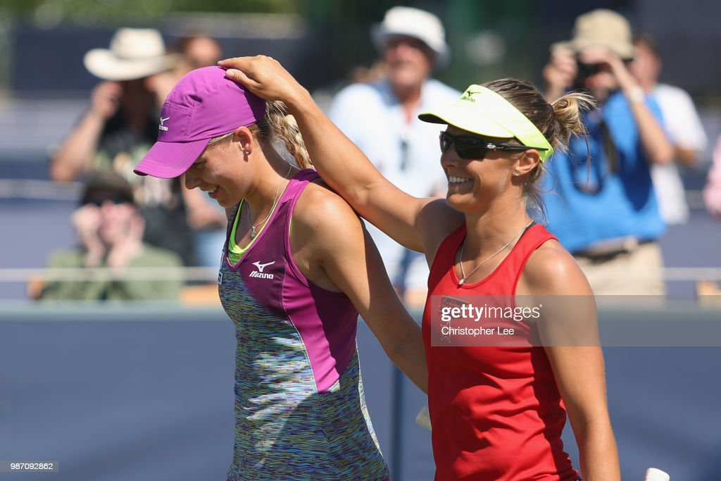 Kirsten Flipkens of Belgium and Johanna Larsson of Sweden celebrate their victory after they beat Alicja Rosolska of Poland and Abigail Spears of USA in the Womens Doubles Final match during of the Fuzion 100 Southsea Trophy at Canoe Lake Leisure on June 29, 2018 in Portsmouth, United Kingdom.