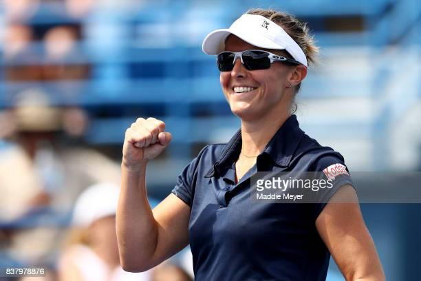 Kirsten Flipkens of Belgium celebrates after defeating Ana Bogdan of Romania during Day 6 of the Connecticut Open at Connecticut Tennis Center at...