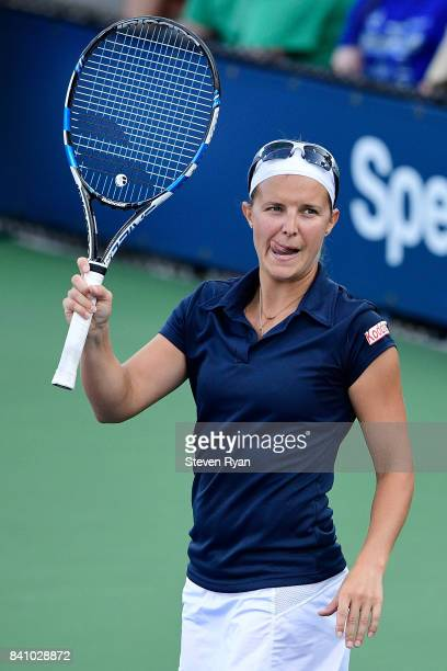 Kirsten Flipkens of Belgium celebrates defeating Madison Brengle of the United States in their first round Women's Single match on Day Three of the...