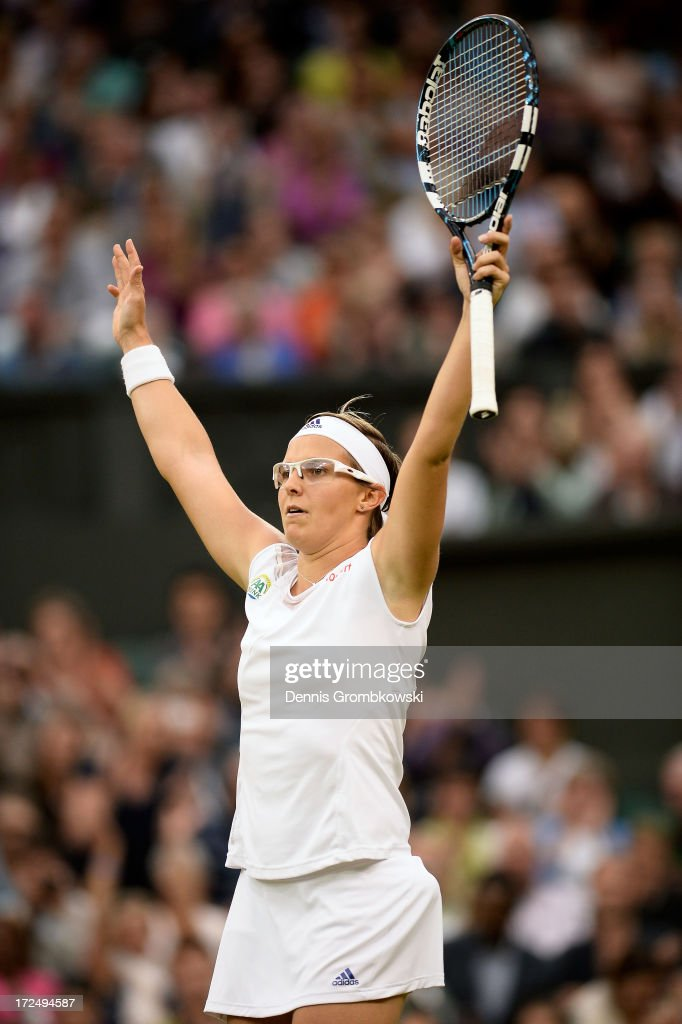 Kirsten Flipkens of Belgium celebrates match point during the Ladies' Singles quarter-final match against Petra Kvitova of Czech Republic on day eight of the Wimbledon Lawn Tennis Championships at the All England Lawn Tennis and Croquet Club at Wimbledon on July 2, 2013 in London, England.