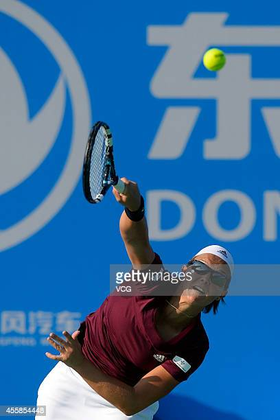Kirsten Flipkens of Belgium competes with Francesca Schiavone of Italy during day 1 of the 2014 Dongfeng Motor Wuhan Open at Optics Valley...