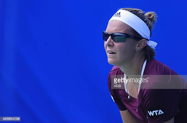 Kirsten Flipkens of Belgium competes with Jarmila Gajdosova of Australia during day three of the 2014 Dongfeng Motor Wuhan Open at Optics Valley...