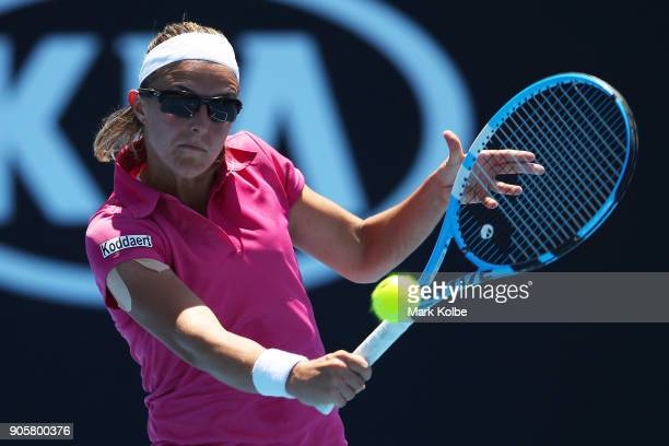Kirsten Flipkens of Belgium plays a backhand in her second round match against Magdalena Rybarikova of Slovakia on day three of the 2018 Australian...