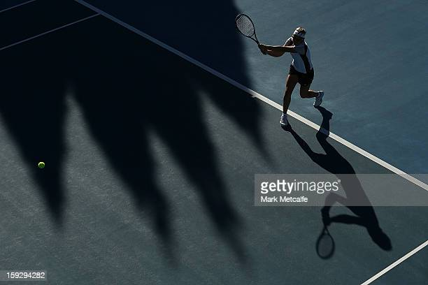 Kirsten Flipkens of Belgium plays a backhand in warm up before her semi final match against Mona Barthel of Germany during day eight of the Hobart...