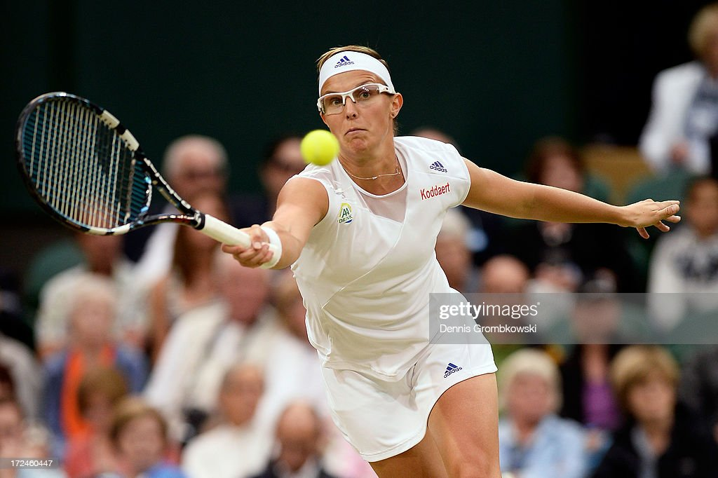 Kirsten Flipkens of Belgium plays a forehand during the Ladies' Singles quarter-final match against Petra Kvitova of Czech Republic on day eight of the Wimbledon Lawn Tennis Championships at the All England Lawn Tennis and Croquet Club at Wimbledon on July 2, 2013 in London, England.