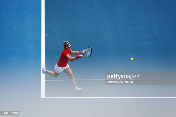 Kirsten Flipkens of Belgium plays a forehand in her first round match against Donna Vekic of Croatia during day one of the ASB Women's Classic at ASB...