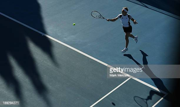 Kirsten Flipkens of Belgium plays a forehand in warm up before her semi final match against Mona Barthel of Germany during day eight of the Hobart...