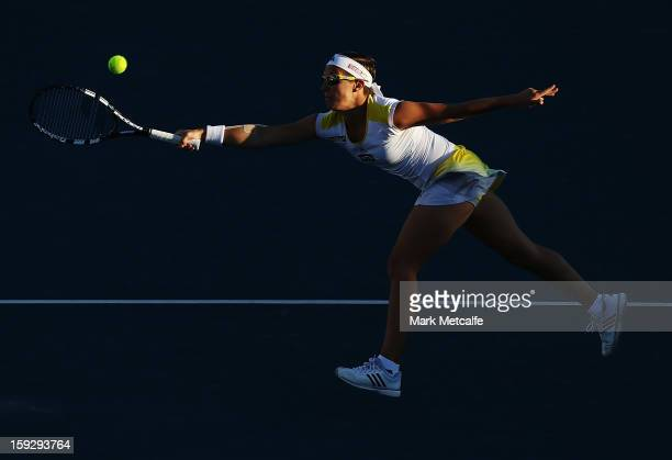 Kirsten Flipkens of Belgium plays a forehand volley in her semi final match against Mona Barthel of Germany during day eight of the Hobart...