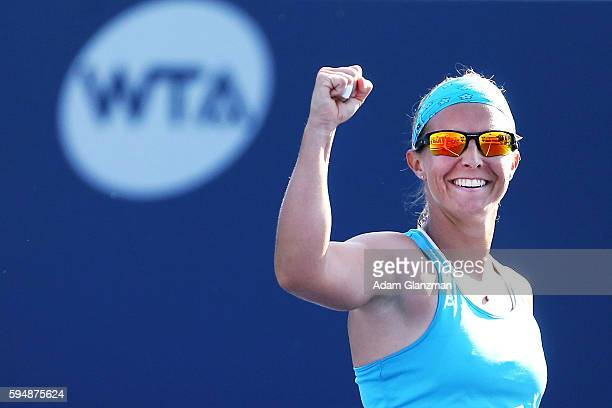 Kirsten Flipkens of Belgium reacts after her victory over Caroline Garcia on day 4 of the Connecticut Open at the Connecticut Tennis Center at Yale...