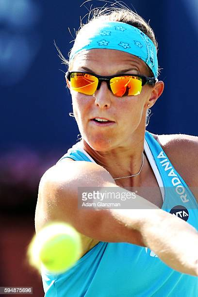 Kirsten Flipkens of Belgium returns a shot during her match against Caroline Garcia on day 4 of the Connecticut Open at the Connecticut Tennis Center...