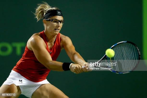 Kirsten Flipkens of Belgium returns a shot to Dominika Cibulkova of Slovakia during the Miami Open at the Crandon Park Tennis Center on March 25 2017...