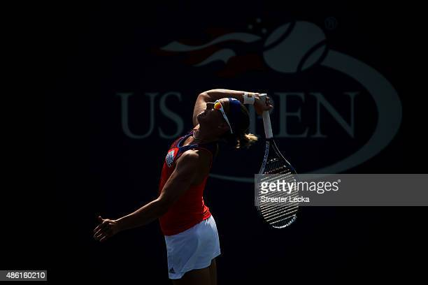 Kirsten Flipkens of Belgium serves against Varvara Lepchenko of the United States during their Women's Singles First Round match on Day Two of the...