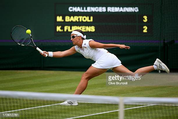 Kirsten Flipkens of Belgium stretches to hit a forehand during the Ladies' Singles semi final match against Marion Bartoli of France on day ten of...