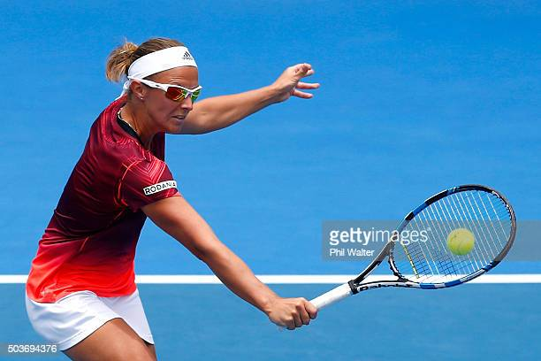 Kirsten Flipkens of Belguim plays a backhand against Tamira Paszek of Austria during day four of the 2016 ASB Classic at ASB Tennis Arena on January...