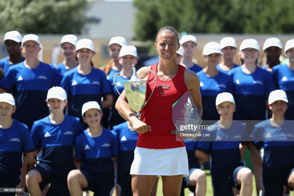 Kirsten Flipkins of Belgium poses with the Winners Trophies after her victory over Katie Boulter of Great Britain in the Womens Singles Final match during of the Fuzion 100 Southsea Trophy at Canoe Lake Leisure on June 29, 2018 in Portsmouth, United Kingdom.