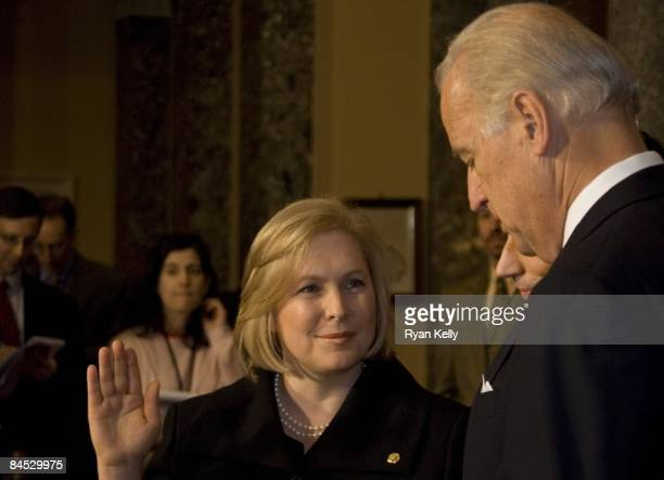 Kirsten Gillibrand is swornin as New York's junior senator to replace Hillary Rodham Clinton To the right is Vice President Joseph R Biden Jr and in...