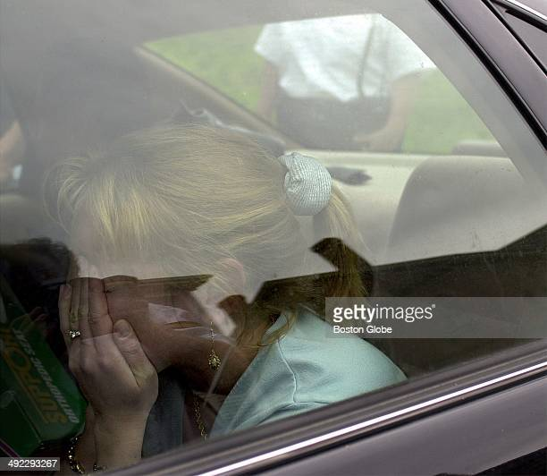 Kirsten Greineder daughter of Dr Dirk Greineder breaks down into tears as she sits in the car to leave Norfolk Superior Court after hearing her...