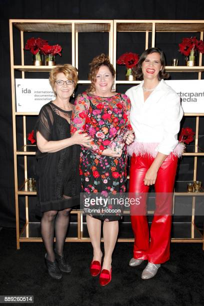Kirsten Johnson Abigail Disney and Gini Reticker pose with the Amicus Award at the 33rd Annual IDA Documentary Awards at Paramount Theatre on...