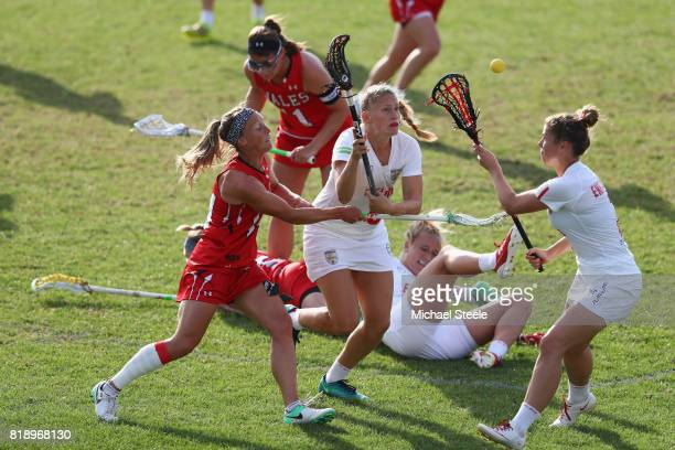 Kirsten Lafferty and Sophie Brett of England compete for the ball with Becky Gaunt of Wales during the quarter final match between England and Wales...