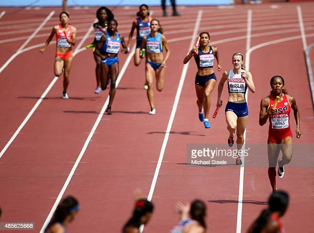 Kirsten McAslan of Great Britain and Sanya RichardsRoss of United States prepare to change over during the Women's 4x400 Metres Relay heats during...