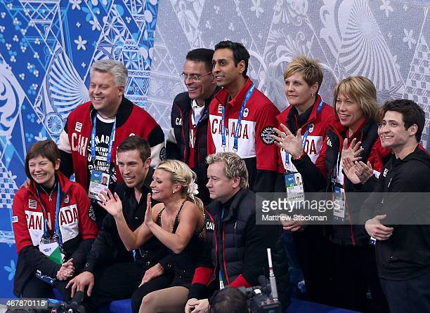 Kirsten MooreTowers and Dylan Moscovitch of Canada wait for their score with teammates and coaches during the Figure Skating Team Pairs Free Skating...