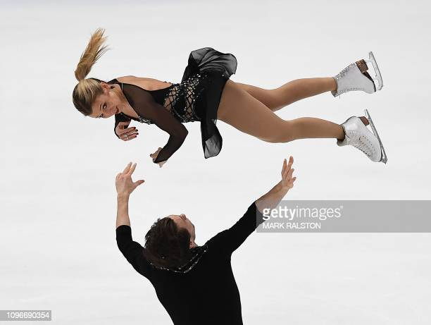 Kirsten MooreTowers and her partner Michael Marinaro of Canada compete before finishing second in the Pairs competition during the ISU Four...