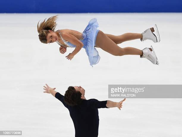 Kirsten Moore-Towers and her partner Michael Marinaro of Canada compete before getting the highest score during the Pairs Short Program during the...