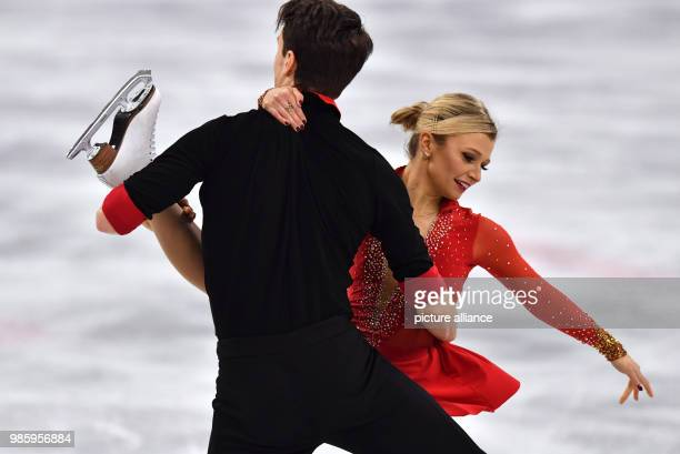 Kirsten MooreTowers and Michael Marinaro from Canada in action during the figure skating pairs short program of the 2018 Winter Olympics in the...