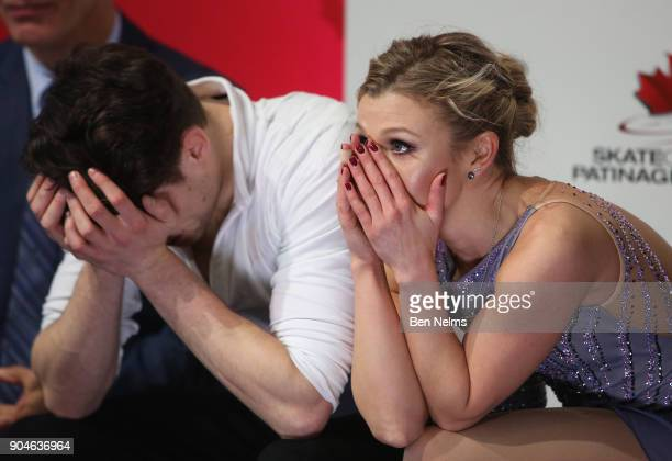 Kirsten MooreTowers and Michael Marinaro of Canada await their score after competing in the free pair program during the 2018 Canadian Tire National...