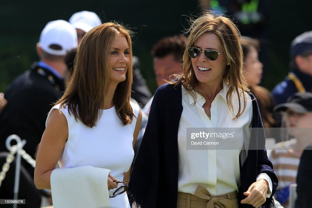Kirsten Norman (L), wife of International Team captain Greg Norman and Midge Trammell (R), partner of U.S. Team captain Fred Couples, are introduced during Opening Ceremonies prior to the start of the 2011 Presidents Cup at Royal Melbourne Golf Course on November 16, 2011 in Melbourne, Australia.