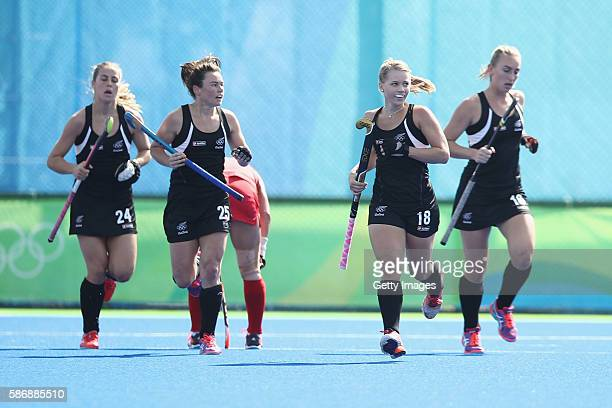 Kirsten Pearce of New Zealand celebrates after scoring a goal during the women's pool A match between New Zealand and the Republic of Korea on Day 2...
