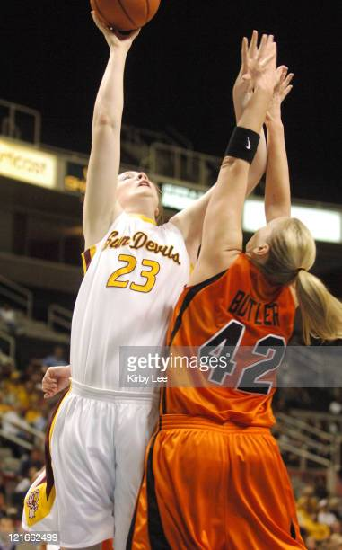 Kirsten Thompson of Arizona State shoots over Kim Butler of Oregon State during Pacific10 Tournament Quarterfinal at the HP Pavilion in San Jose...