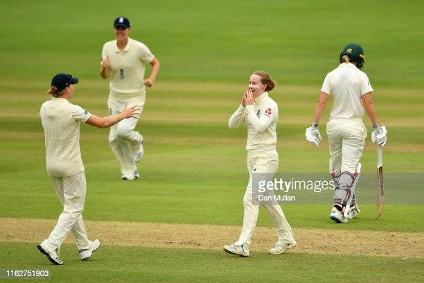 Kirstie Gordon of England celebrates after taking the wicket of Alyssa Healy of Australia during the Kia Women's Test Match between England Women and...