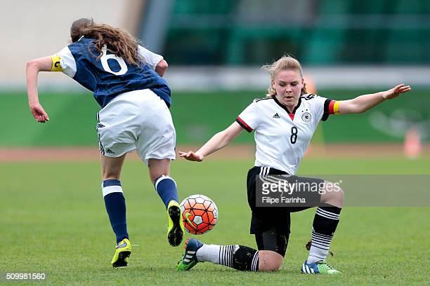 Kirstie McIntosh of Scotland challenges Lara Schejk of Germany during the UEFA Women Under16 match between U16 Scotland v U16 Germany on February 13...