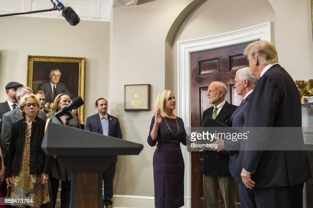 Kirstjen Nielsen secretary of Homeland Security center is sworn in by US Vice President Mike Pence second right next to US President Donald Trump...