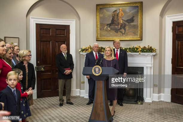 Kirstjen Nielsen secretary of Homeland Security center speaks after being sworn in during a ceremony with US President Donald Trump center right and...