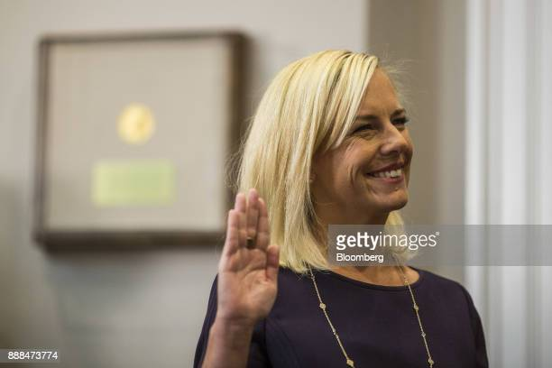 Kirstjen Nielsen secretary of Homeland Security is sworn in during a ceremony in the Roosevelt Room of the White House in Washington DC US on Friday...