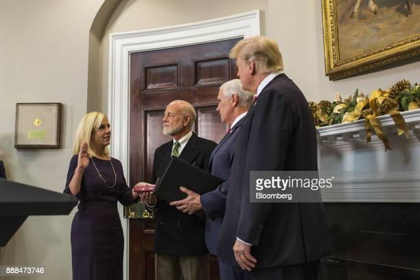 Kirstjen Nielsen secretary of Homeland Security left is sworn in by US Vice President Mike Pence center next to US President Donald Trump right...