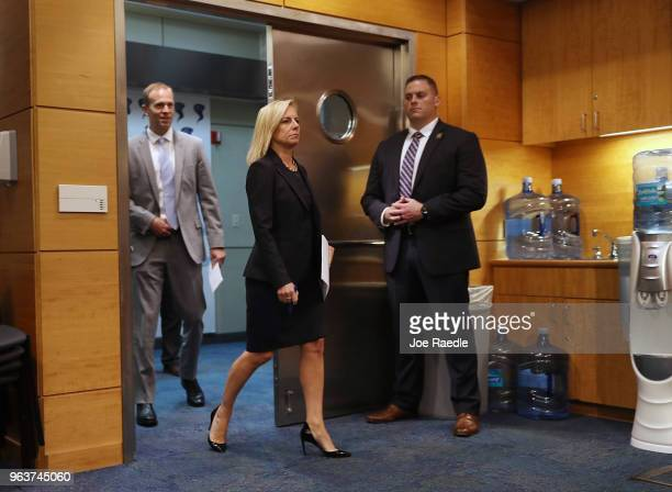 Kirstjen Nielsen the US Homeland Security Secretary and Brock Long FEMA's director visit the National Hurricane Center on May 30 2018 in Miami...