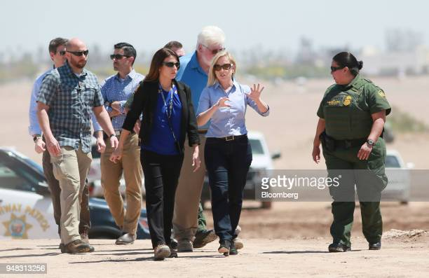 Kirstjen Nielsen US secretary of Homeland Security center right tours border wall construction with Border Patrol officials in Calexico California on...