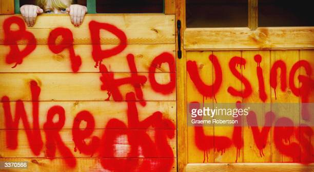 Kirsty aged 9 poses by a derelict play house as part of a charity photocall to launch a campaign to end bad housing for children April 15 2004 in...