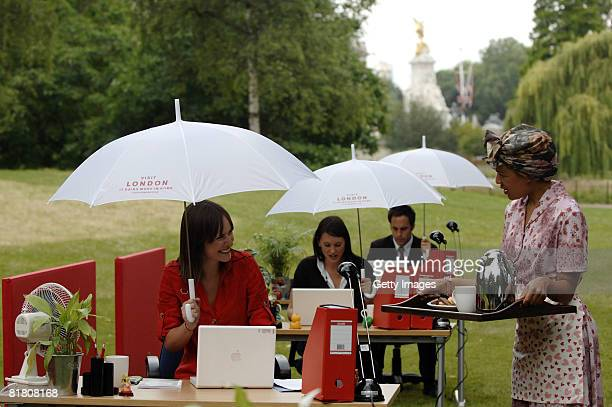 Kirsty Burgess chats with the Tea Lady while at her desk in St James' Park on July 3 2008 in London Visit London has transformed St James' Park into...