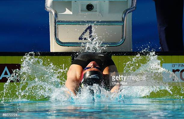 Kirsty Coventry of Zimbabwe competes in the Women's 100m Backstroke Heats during the 13th FINA World Championships at the Stadio del Nuoto on July 27...