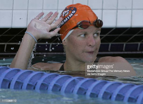 Kirsty Coventry waves after wining the finals of the women's 200 individual medley in meet record time of 21408 at the 38th annual Santa Clara...