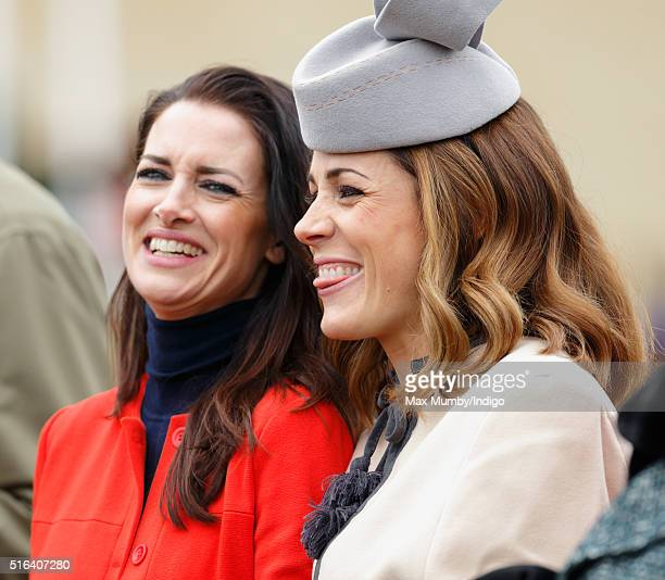 Kirsty Gallacher and Natalie Pinkham watch the racing as they attend day 4 Gold Cup Day of the Cheltenham Festival on March 18 2016 in Cheltenham...
