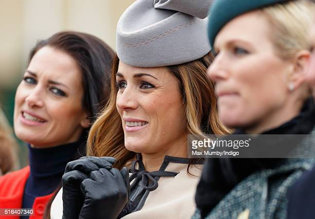 Kirsty Gallacher Natalie Pinkham and Zara Phillips watch the racing as they attend day 4 Gold Cup Day of the Cheltenham Festival on March 18 2016 in...