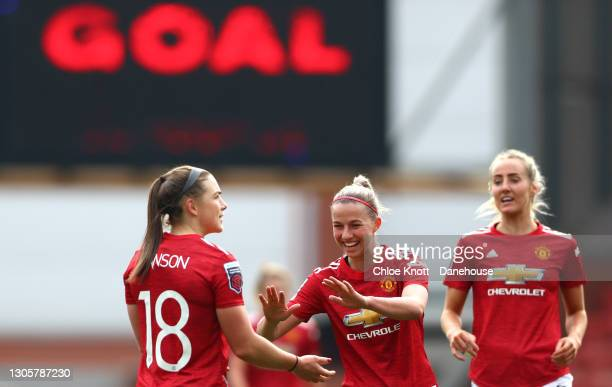 Kirsty Hanson of Manchester United celebrates scoring her teams first goal during the Barclays FA Women's Super League match between Manchester...